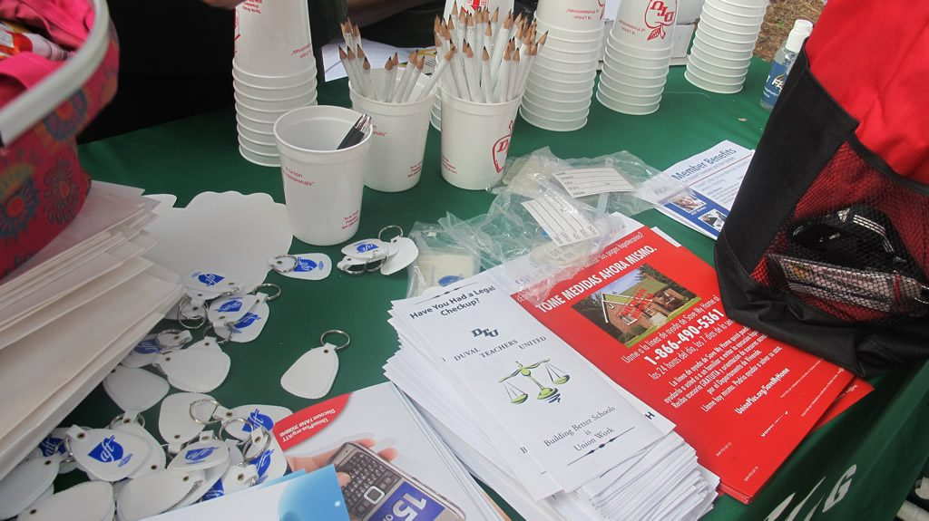 Variety of leaflets and flyers on a green table