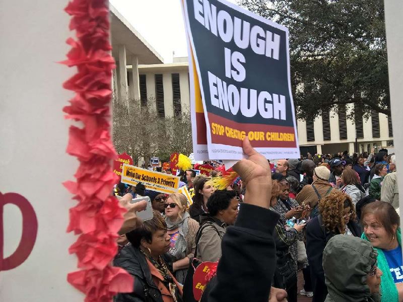 Enough is enough sign being held at rally