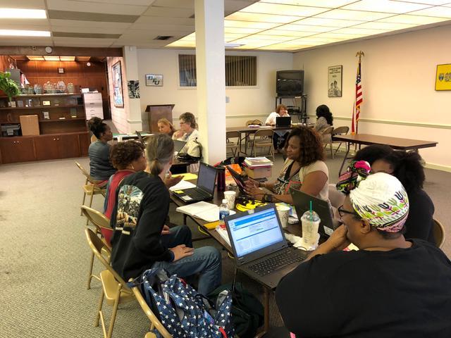People sat at desk on laptops
