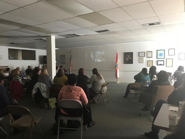 Teachers watching slideshow presentation