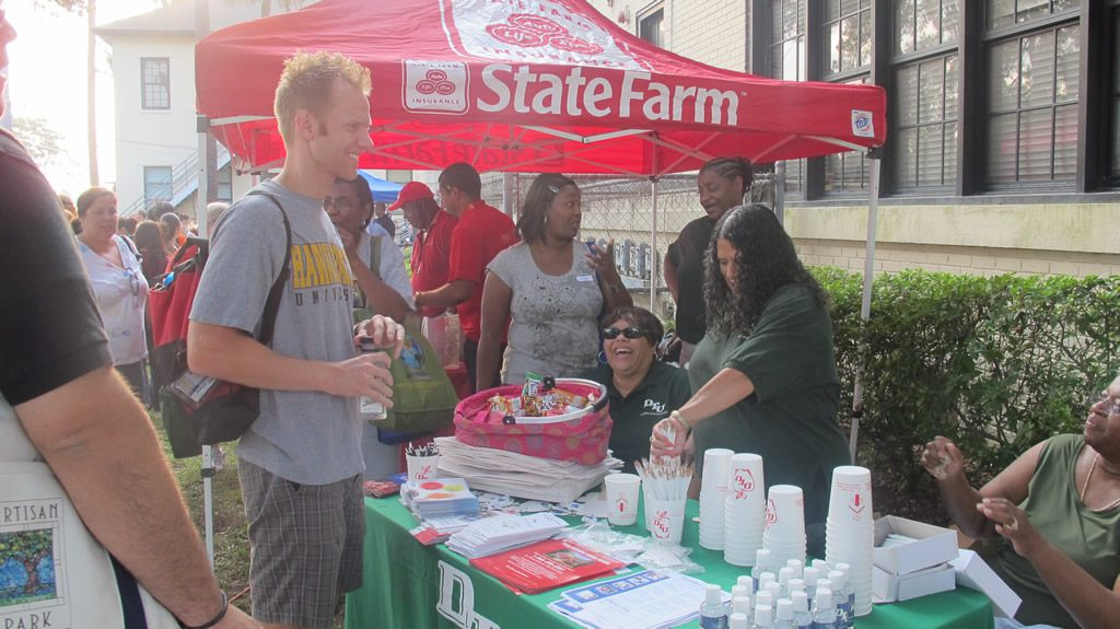 Man with ginger hair infront of state farm event tent